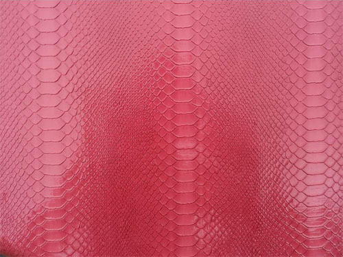 Red snakeskin grain leather